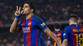 Barcelona's Uruguayan forward Luis Suarez celebrates after scoring the opener during the Spanish Copa del Rey (King's Cup) semi final second leg football match FC Barcelona vs Club Atletico de Madrid at the Camp Nou stadium in Barcelona on February 7, 2017. / AFP PHOTO / Josep Lago
