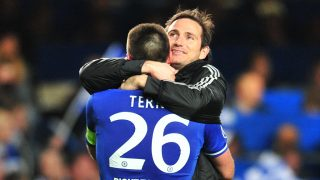 Chelsea's English defender John Terry (L) celebrates their victory with Chelsea's English midfielder Frank Lampard (R) after the final whistle during the UEFA Champions League quarter final second leg football match between Chelsea and Paris Saint-Germain at Stamford Bridge in London on April 8, 2014. Chelsea won 2-0 going through to the semi-final on the away goals rule. AFP PHOTO / GLYN KIRK / AFP PHOTO / GLYN KIRK