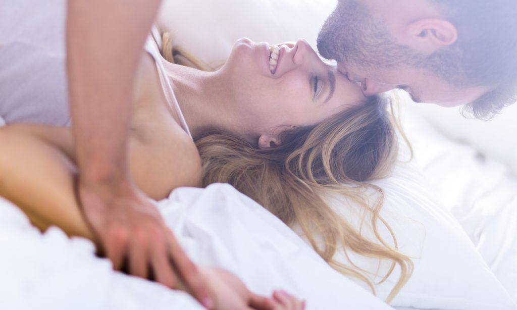 Young passionate married couple during morning sex