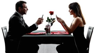 couples lovers dinning on the telephone  in silhouettes on white background