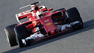 Ferrari's German driver Sebastian Vettel drives at the Circuit de Catalunya on February 27, 2017 in Montmelo on the outskirts of Barcelona during the first day of the first week of tests for the Formula One Grand Prix season.  / AFP PHOTO / JOSE JORDAN