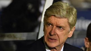 Arsenal's French manager Arsene Wenger awaits kick off in the English FA Cup fifth round football match between Sutton United and Arsenal at the Borough Sports Ground, Gander Green Lane in south London on February 20, 2017. / AFP PHOTO / Glyn KIRK / RESTRICTED TO EDITORIAL USE. No use with unauthorized audio, video, data, fixture lists, club/league logos or 'live' services. Online in-match use limited to 75 images, no video emulation. No use in betting, games or single club/league/player publications.  /