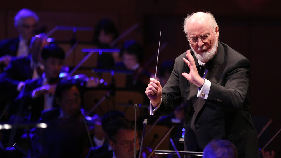 In this handout photo released by the The Los Angeles Philharmonic, Composer and conductor John Williams conducts the Los Angeles Philharmonic Orchestra with the Star Wars theme music Tuesday Sept. 30, 2014 at the Walt Disney Concert Hall in Los Angeles, Calif. (AP Photo/The Los Angeles Philharmonic, Craig T. Mathew)