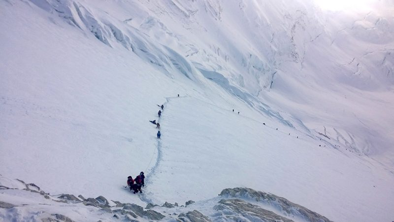 In this photograph taken on May 9, 2016, mountaineers walk from Camp 3 to Camp 4, as they pushing for the summit of Mount Everest. An Indian mountaineer has died on Mount Everest and two of his teammates are missing, expedition organisers said May 23, 2016, as the death toll from the Himalayan climbing season rose to five. Subhash Pal reached the 8,848-metre (29,029-foot) summit on May 21, but collapsed while descending the Hillary Step ice wall and died the following day. He was the third to die on Everest in recent days, after an Australian and a Dutch climber succumbed to altitude sickness. Another two climbers have died on other peaks. / AFP PHOTO / NIMA GYALZEN SHERPA