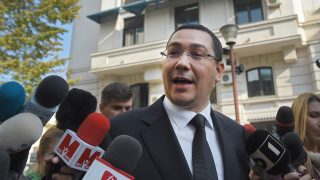 """Former prime minister Victor Ponta addresses journalists as he exits the High Court of Cassation and Justice in Bucharest on November 6, 2015, as he was quoted on the dossier Turceni-Rovinari, charged with forgery of documents under private signature, complicity in tax evasion and money laundering, acts which would committed as a lawyer. Ponta quit on November 4, 2015 after a horrific fire at a Bucharest nightclub left 32 people dead, prompting tens of thousands of people to take to the streets demanding a """"profound change"""" in the government as a wave of grief and anger swept the country. AFP PHOTO / DANIEL MIHAILESCU / AFP PHOTO / DANIEL MIHAILESCU"""