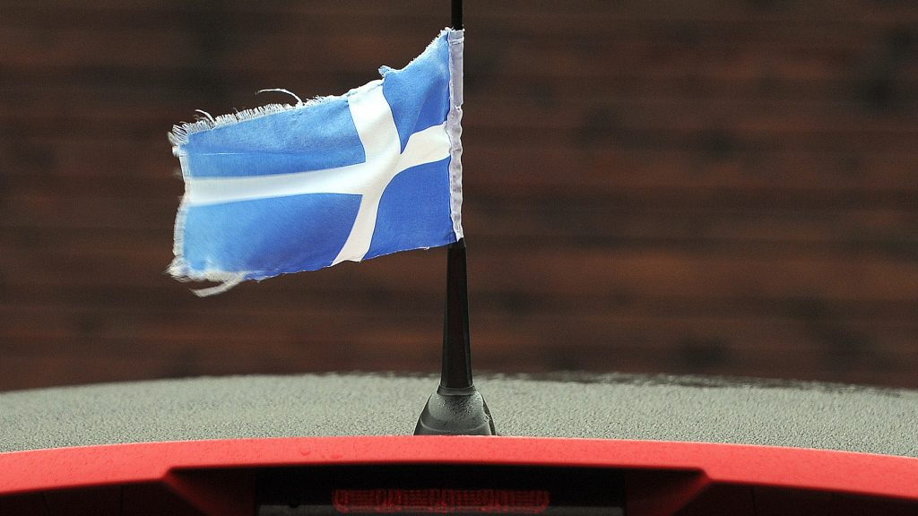 A Flag of Shetland flies from the aerial of a car near Lerwick Harbour in Lerwick, Shetland Islands, on February 1, 2017. / AFP PHOTO / ANDY BUCHANAN