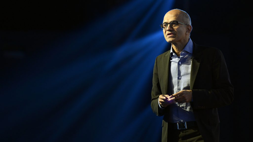 Microsoft CEO Satya Nadella addresses IT professionals and business leaders during a summit in Mumbai on February 22, 2017. / AFP PHOTO / PUNIT PARANJPE