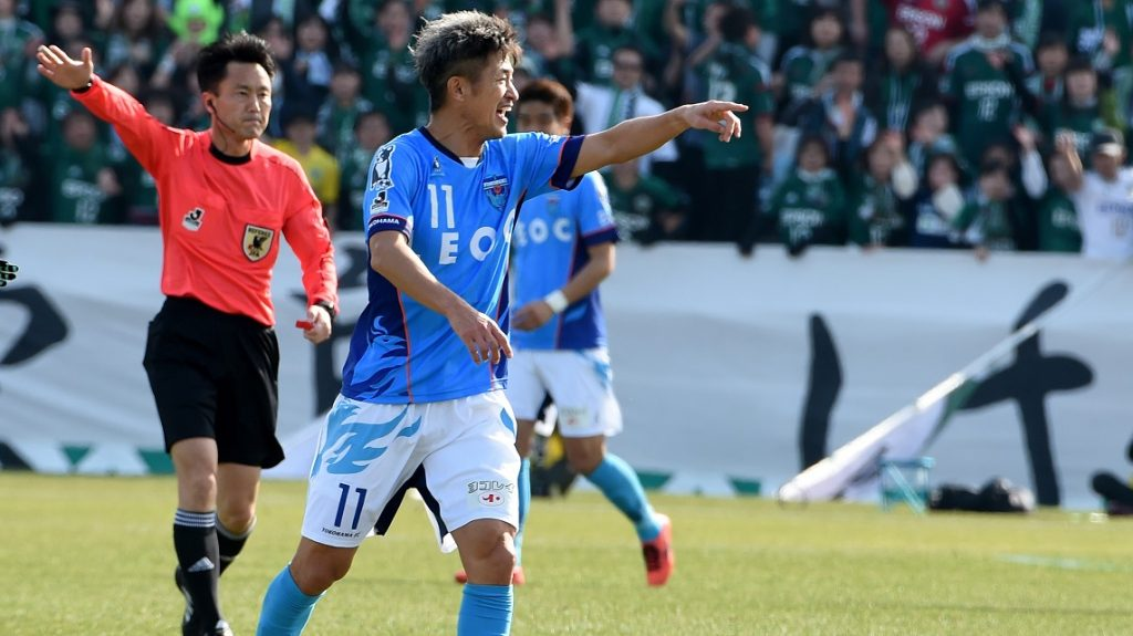 Former Japan striker Kazuyoshi Miura (C) of the J-League second-tier club Yokohama FC plays during the opening match of 2017 season against Matsumoto Yamaga in Yokohama, suburb of Tokyo, on February 26, 2017.  Miura took part in the match on his 50th birthday. / AFP PHOTO / TORU YAMANAKA