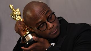 """Winner for Best Director """"Moonlight"""" Barry Jenkins holds his trophy  at the 89h Annual Academy Awards Governors Ball in Hollywood, California, on February 26, 2017. / AFP PHOTO / ANGELA WEISS"""