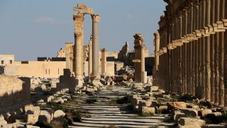 (FILES) This file photo taken on March 31, 2016 shows the remains of the destroyed Arc du Triomphe lie at the end of the the Great Colonnade in the ancient city of Palmyra in central Syria. Syrian troops have pushed into Palmyra as they battle to retake the iconic city from the Islamic State group, but their advance was slowed on March 2, 2017, by landmines laid by retreating jihadists. / AFP PHOTO / JOSEPH EID