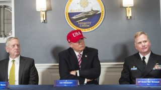 US President Donald Trump (C), Secretary of Defense James Mattis (L) and US Navy Captain Richard McCormack (R) attend an operations briefing at the pre-commissioned USS Gerald R. Ford aircraft carrier in Newport News, Virginia, March 2, 2017. / AFP PHOTO / SAUL LOEB