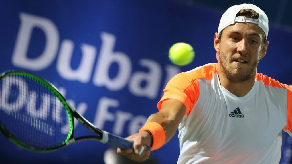 France's Lucas Pouille returns the ball to world number one Andy Murray of Great Britain during their ATP semi-final tennis match as part of the Dubai Duty Free Championships on March 3, 2017. / AFP PHOTO / KARIM SAHIB