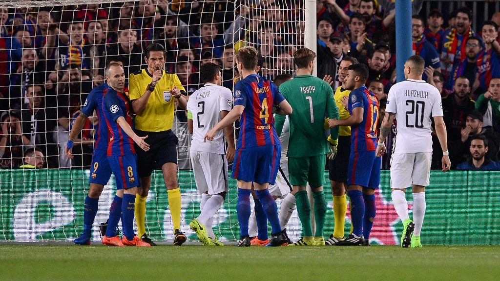 German referee Deniz Aytekin (2ndL) whistles and point the penalty mark during the UEFA Champions League round of 16 second leg football match FC Barcelona vs Paris Saint-Germain FC at the Camp Nou stadium in Barcelona on March 8, 2017. / AFP PHOTO / Josep Lago