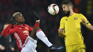Manchester United's French midfielder Paul Pogba (L) fights for the ball with Rostov's Slovenian defender Miha Mevlja during the UEFA Europa League round of 16 football match between Rostov and Manchester United at Olimp-2 Arena in Rostov-on-Don on March 9, 2017. / AFP PHOTO / Alexander NEMENOV