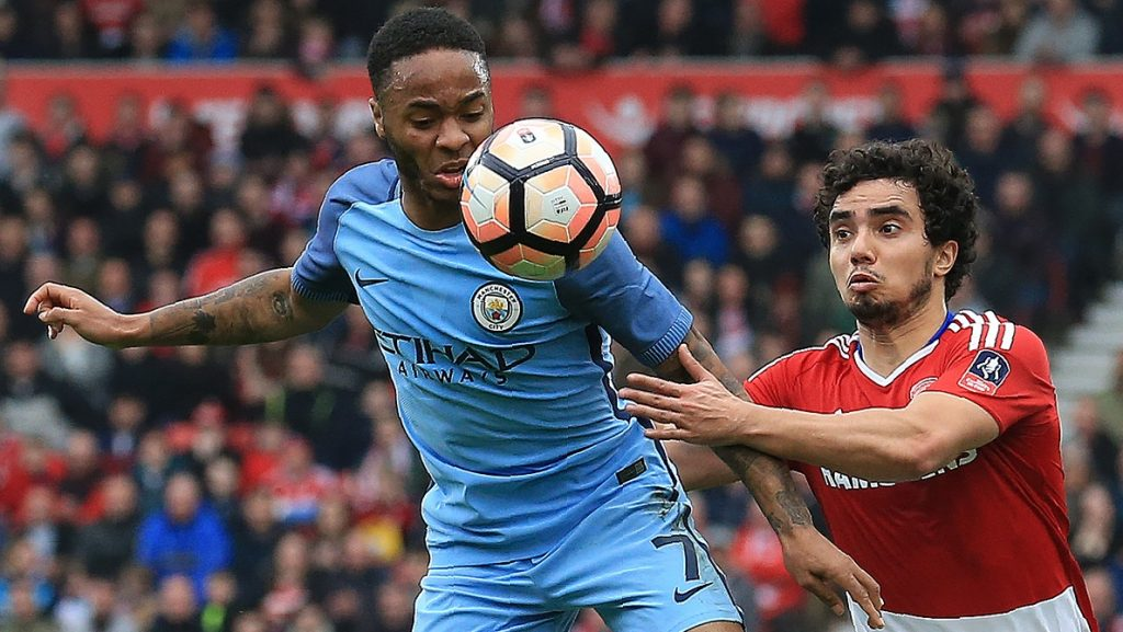 Manchester City's English midfielder Raheem Sterling (L) vies with Middlesbrough's Brazilian defender Fabio during the English FA cup quarter final football match between Middlesbrough and Manchester City at the Riverside Stadium in Middlesbrough, north east England on March 11, 2017. / AFP PHOTO / Lindsey PARNABY / RESTRICTED TO EDITORIAL USE. No use with unauthorized audio, video, data, fixture lists, club/league logos or 'live' services. Online in-match use limited to 75 images, no video emulation. No use in betting, games or single club/league/player publications.  /