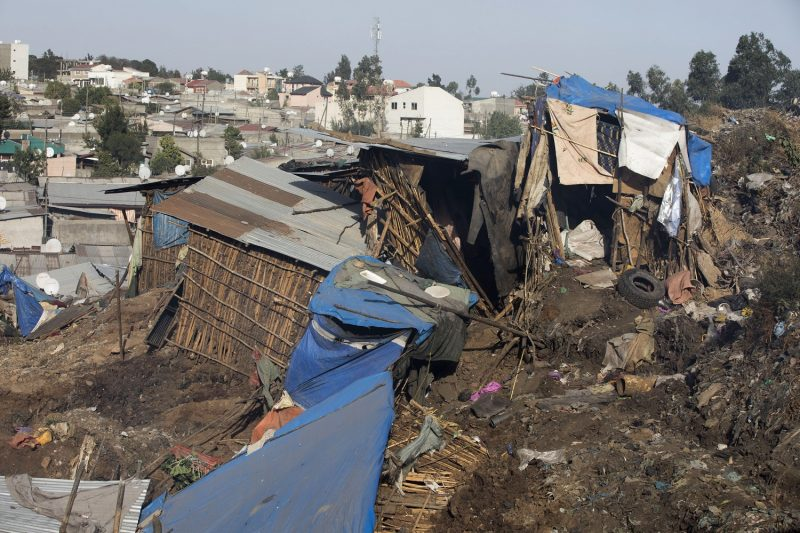 A photo taken on March 12, 2017 shows damaged dwellings after a landslide in the main city dump of Addis Ababa left at least 30 people dead. At least 30 people died and dozens more were hurt in a giant landslide at Ethiopia's largest rubbish dump outside Addis Ababa, a tragedy squatters living there blamed on a biogas plant being built nearby. The landslide saw dozens of homes of people living in the dump levelled after a part of the largest pile of rubbish at the Koshe landfill collapsed, an AFP journalist said.  / AFP PHOTO / ZACHARIAS ABUBEKER