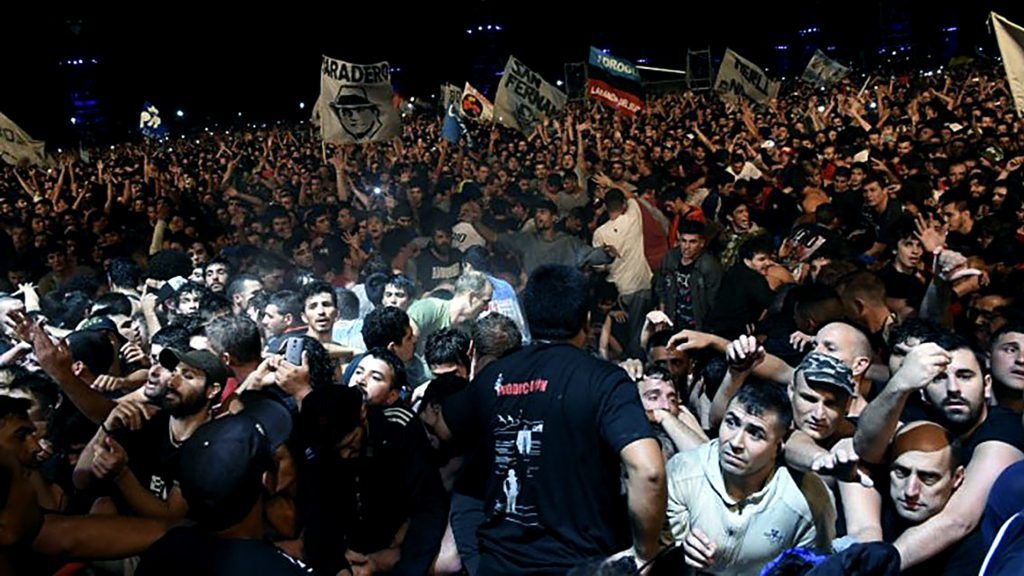 Hundreds crowd together during the show by Argentine musician and song-writer Carlos Alberto Solari -better known for his nickname Indio- in La Colmena, Olavarria, Buenos Aires province, late at night on March 11, 2017.   Two people were killed and many more injured when a crush of patrons thronged into the rock concert early Sunday, officials said. / AFP PHOTO / NOTICIAS ARGENTINAS / Andres ARONUXET / Argentina OUT / RESTRICTED TO EDITORIAL USE - MANDATORY CREDIT AFP PHOTO /  NA-Andres ARONUXET - NO MARKETING - NO ADVERTISING CAMPAIGNS - DISTRIBUTED AS A SERVICE TO CLIENTS