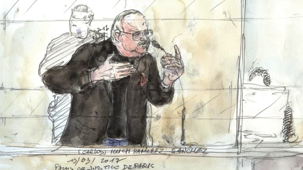 A court sketch made on March 13, 2017 shows Ilyich Ramirez Sanchez, known as  Carlos the Jackal, gesturing during his trial in France for the deadly bombing of the Drugstore Publicis, a busy shop once located in Saint-Germain-des-Pres in the French capital Paris more than 40 years ago.    Carlos, 67, a Venezuelan whose real name is Ilyich Ramirez Sanchez was arrested in the Sudanese capital Khartoum in 1994 by elite French police. He is already serving a life sentence for the murders of two policemen killed in Paris in 1975 and that of a Lebanese revolutionary. He was also found guilty of four bombings in Paris and Marseille in 1982 and 1983, some targeting trains, which killed a total of 11 people and injured nearly 150.   / AFP PHOTO / Benoit PEYRUCQ
