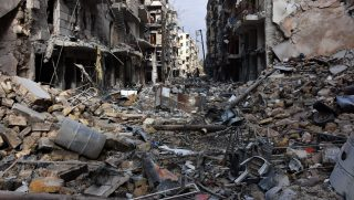 (FILES) This file photo taken on December 7, 2016 shows general view of destruction in the al-Shaar neighbourhood after government forces took control of the area in the eastern part of the northern city of Aleppo. Syria's war has killed just over 320,000 people since it erupted six years ago, the Britain-based Syrian Observatory for Human Rights said on March 13, 2017, noting that a fragile ceasefire had helped to slow the rising death toll. / AFP PHOTO / GEORGE OURFALIAN