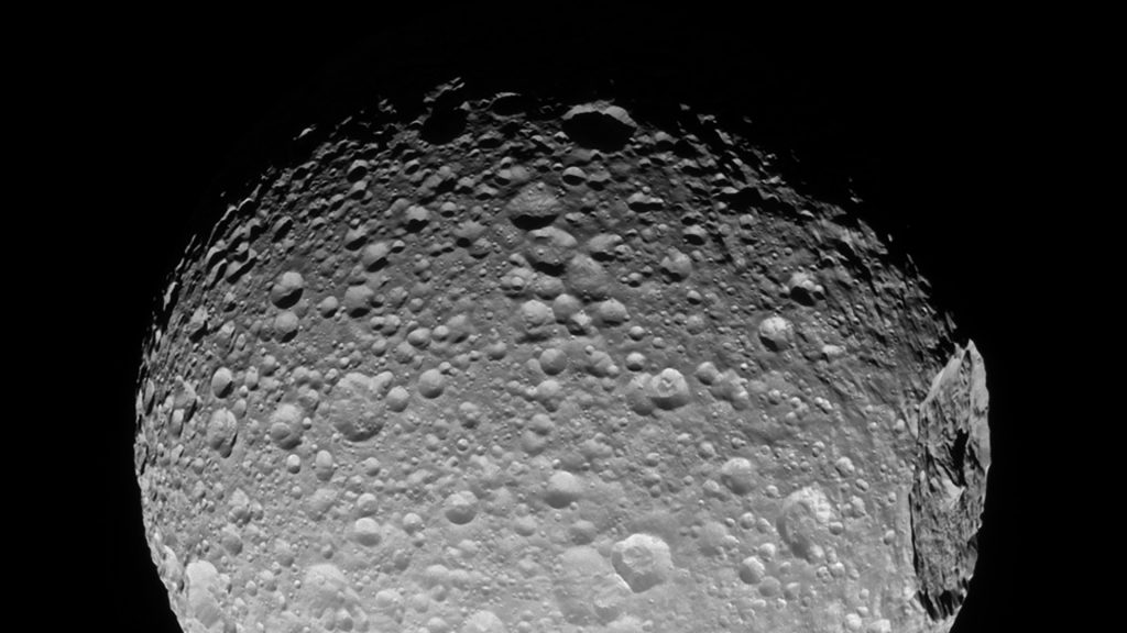 This NASA imaage released March 13, 2017 shows Mimas' gigantic crater Herschel as it lies near the moon's limb in this Cassini view.     When large impacts happen, they deliver tremendous amounts of energy -- sometimes enough to cause global destruction.  Even impacts that are not catastrophic can leave enormous, near-permanent scars on bodies like Mimas (246 miles or 396 kilometers across).This view looks toward the anti-Saturn hemisphere of Mimas. North on Mimas is up and rotated 32 degrees to the left. The image was taken in visible light with the Cassini spacecraft narrow-angle camera on November 19, 2016.The view was acquired at a distance of approximately 53,000 miles (85,000 kilometers) from Mimas. Image scale is 1,677 feet (511 meters) per pixel. / AFP PHOTO / NASA/JPL-Caltech/Space Science Institute / Handout / RESTRICTED TO EDITORIAL USE - MANDATORY CREDIT AFP PHOTO /NASA/JPL-Caltech/Space Science Institute  - NO MARKETING - NO ADVERTISING CAMPAIGNS - DISTRIBUTED AS A SERVICE TO CLIENTS