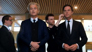 Netherlands' far-right politician Geert Wilders (L) of the PVV party and Netherlands' prime minister Mark Rutte of the VVD Liberal party prepare to debate one another on March 13, 2017 in Rotterdam, prior to Dutch parliamentary elections. / AFP PHOTO / POOL / YVES HERMAN
