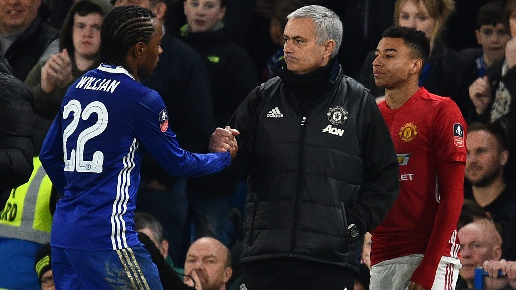 Manchester United's Portuguese manager Jose Mourinho (C) gestures to Chelsea's Brazilian midfielder Willian as he comes off during the English FA Cup quarter final football match between Chelsea and Manchester United at Stamford Bridge in London on March 13, 2017. / AFP PHOTO / Glyn KIRK / RESTRICTED TO EDITORIAL USE. No use with unauthorized audio, video, data, fixture lists, club/league logos or 'live' services. Online in-match use limited to 75 images, no video emulation. No use in betting, games or single club/league/player publications.  /