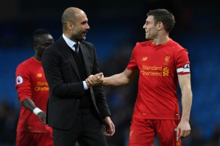 Manchester City's Spanish manager Pep Guardiola (L) speaks with Liverpool's English midfielder James Milner after the English Premier League football match between Manchester City and Liverpool at the Etihad Stadium in Manchester, north west England, on March 19, 2017. / AFP PHOTO / Paul ELLIS / RESTRICTED TO EDITORIAL USE. No use with unauthorized audio, video, data, fixture lists, club/league logos or 'live' services. Online in-match use limited to 75 images, no video emulation. No use in betting, games or single club/league/player publications.  /