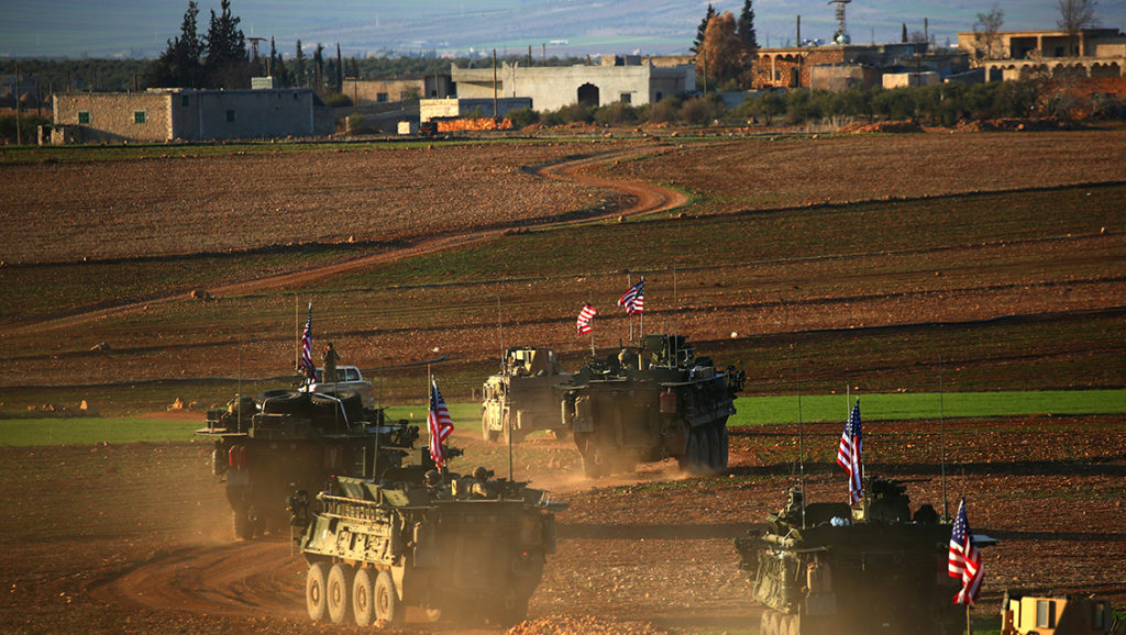 (FILES) This file photo taken on March 05, 2017 shows a convoy of US forces armoured vehicles driving near the village of Yalanli, on the western outskirts of the northern Syrian city of Manbij, on March 5, 2017.Russia's military will train Kurdish forces in Syria, the militia's spokesman said on March 20, 2017, in Moscow's first agreement of its kind with the group that controls large parts of the country's north. / AFP PHOTO / DELIL SOULEIMAN