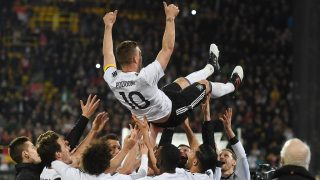 Teammates throw Germany's midfielder Lukas Podolski in the air after the friendly football match of Germany vs England in Dortmund, western Germany, on Marcht 22, 2017. It is Lukas Podolski's last match with the German team. / AFP PHOTO / dpa / Bernd Thissen / Germany OUT