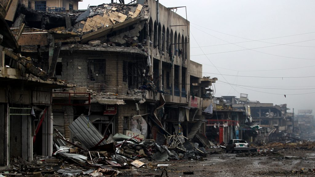 """A general view shows a destroyed street as the Iraqi counter-terrorism service (CTS) advance towards the Yabasat neighbourhood on March 23, 2017 during their ongoing offensive to push Islamic State (IS) jihadists out of Mosul.  About 600,000 people remain in the areas of west Mosul held by the Islamic State group, including 400,000 who are """"trapped"""" in the Old City under siege-like conditions, the UN said. / AFP PHOTO / AHMAD AL-RUBAYE"""
