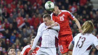 Swiss midfielder Josip Drmic (C) scores the first goal during the WC 2018 qualifying football match Switzerland vs Latvia on March 25, 2017 at the Stade de Geneve in Geneva. / AFP PHOTO / Fabrice COFFRINI