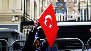 TURKEY, Istanbul: People gather outside of the Dutch Consulate in Istanbul, Turkey on March 12, 2017, to demonstrate against the Netherlands after the country stopped Turkish Foreign Minister Mevlut Cavusoglu from entering. The protesters sang the Turkish national anthem and waved flags. - Ekrem Koray  Berkin