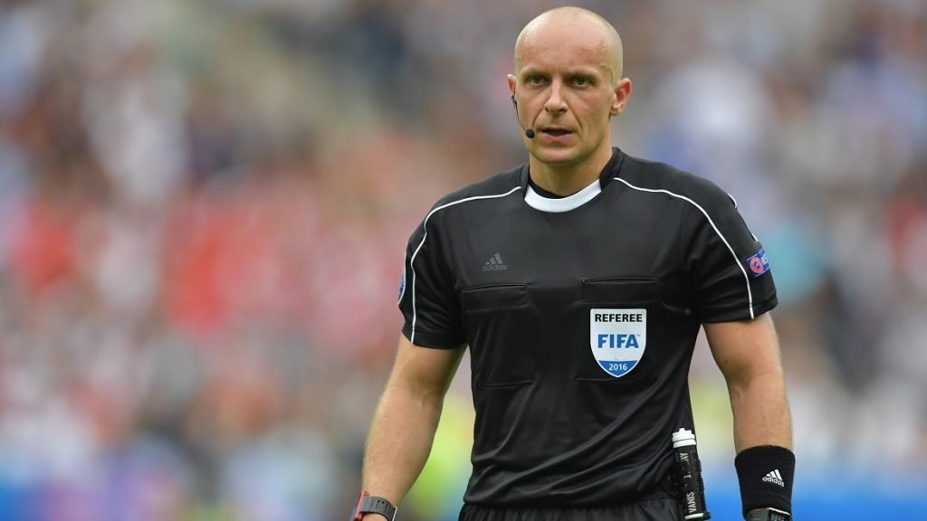 Referee Szymon Marciniak of Poland looks on during the Group F preliminary round soccer match of the UEFA EURO 2016 between Iceland and Austria at the Stade de France in St. Denis, France, 22 June 2016. Photo: Peter Kneffel/dpa (RESTRICTIONS APPLY: For editorial news reporting purposes only. Not used for commercial or marketing purposes without prior written approval of UEFA. Images must appear as still images and must not emulate match action video footage. Photographs published in online publications (whether via the Internet or otherwise) shall have an interval of at least 20 seconds between the posting.)