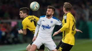 Dortmund's Lukasz Piszczek (R) and Christian Pulisic and Lotte's Kevin Pires-Rodrigues  vie for the ball during the German DFB Cup soccer match between SF Lotte and Borussia Dortmund at the Stadium an der Bremer Brueckein Osnabrück,Germany, 14 March 2017.   (EMBARGO CONDITIONS - ATTENTION: The DFB prohibits the utilisation and publication of sequential pictures on the internet and other online media during the match (including half-time). ATTENTION: BLOCKING PERIOD! The DFB permits the further utilisation and publication of the pictures for mobile services (especially MMS) and for DVB-H and DMB only after the end of the match.) Photo: Guido Kirchner/dpa