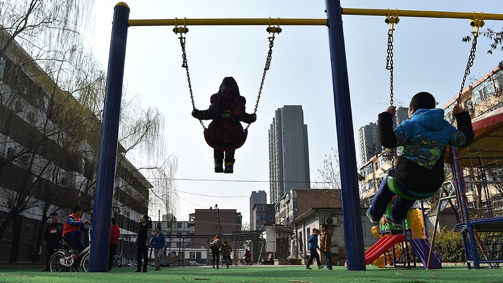 (170330) -- TAIYUAN, March 30, 2017 (Xinhua) -- Children play swings at a service center of the Lingxing community in Taiyuan, capital of north China's Shanxi Province, March 28, 2017. Established in 2010, the service center has accommodated over 60 children with autism. A total of 29 teachers take part in the rehabilitation program to help these children. April 2 marks the World Autism Awareness Day.  (Xinhua/Zhan Yan) (hdt)