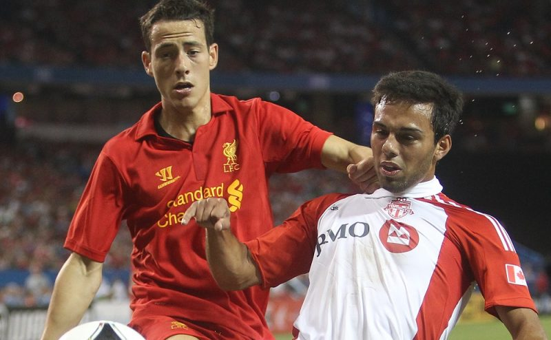 TORONTO, CANADA - JULY 21: Ryan Johnson #9 of Toronto FC controls the ball against Krisztian Adorjan #51 of Liverpool during the World Football Challenge friendly match on July 21, 2012 at Rogers Centre in Toronto, Ontario, Canada.   Tom Szczerbowski/Getty Images/AFP