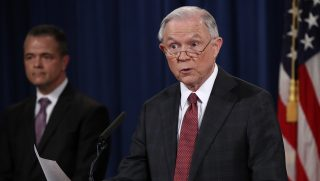 WASHINGTON, DC - MARCH 02: U.S. Attorney General Jeff Sessions (R) answers questions during a press conference at the Department of Justice on March 2, 2017 in Washington, DC. Sessions addressed the calls for him to recuse himself from Russia investigations after reports surfaced of meetings he had with the Russian ambassador during the U.S. presidential campaign. Also pictured is Sessions' Chief of Staff Jody Hunt (L).   Win McNamee/Getty Images/AFP