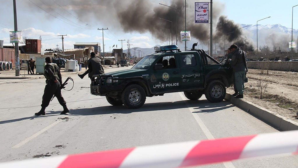 KABUL, AFGHANISTAN-MARCH 01: Afghan security officials take position as smoke rises after terrorist attack, claimed by Taliban on a Military base in Kabul, Afghanistan on March 1, 2017. Explosions and gunfire ring out at security compounds in Kabul. Haroon Sabawoon / Anadolu Agency