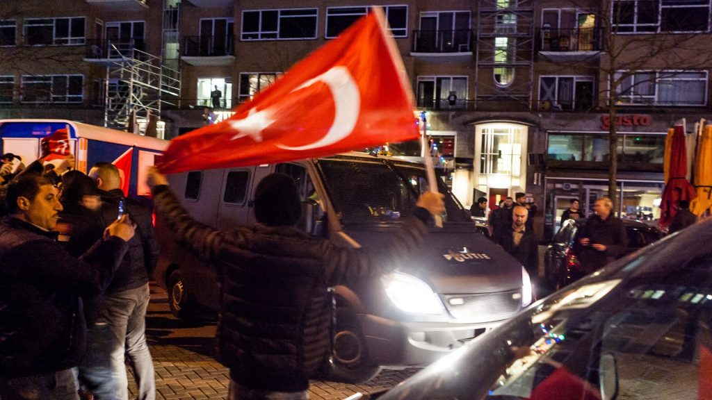 ROTTERDAM, NETHERLANDS - MARCH 12: Dutch police intervene the Turkish citizens gathering outside Turkish consulate in Rotterdam to protest Dutch government after its ban on ministers, in Rotterdam, Netherlands on March 12, 2017. The Dutch government on Saturday canceled the flight permit for Turkish Foreign Minister's Mevlut Cavusoglu and blocked Turkish Family Minister Fatma Betul Sayan Kaya's convoy from entering the Turkish consulate in Rotterdam.  Paco Nunez / Anadolu Agency