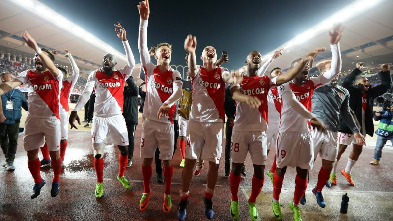 Monaco's players celebrate at the end of the UEFA Champions League round of 16 football match between Monaco and Manchester City at the Stade Louis II in Monaco on March 15, 2017. / AFP PHOTO / Valery HACHE