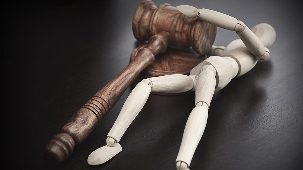 Wooden Human Figurine Pulling Judges or Auctioneers Hammer, Trial Or Auction Concept