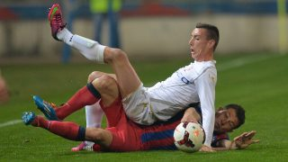 Andrei Prepelita (R) of Steaua Bucharest vies for the ball with Sergiu Oltean (L) of FC Botosani during Romania's First League football match in Bucharest city March 31, 2014. AFP PHOTO DANIEL MIHAILESCU