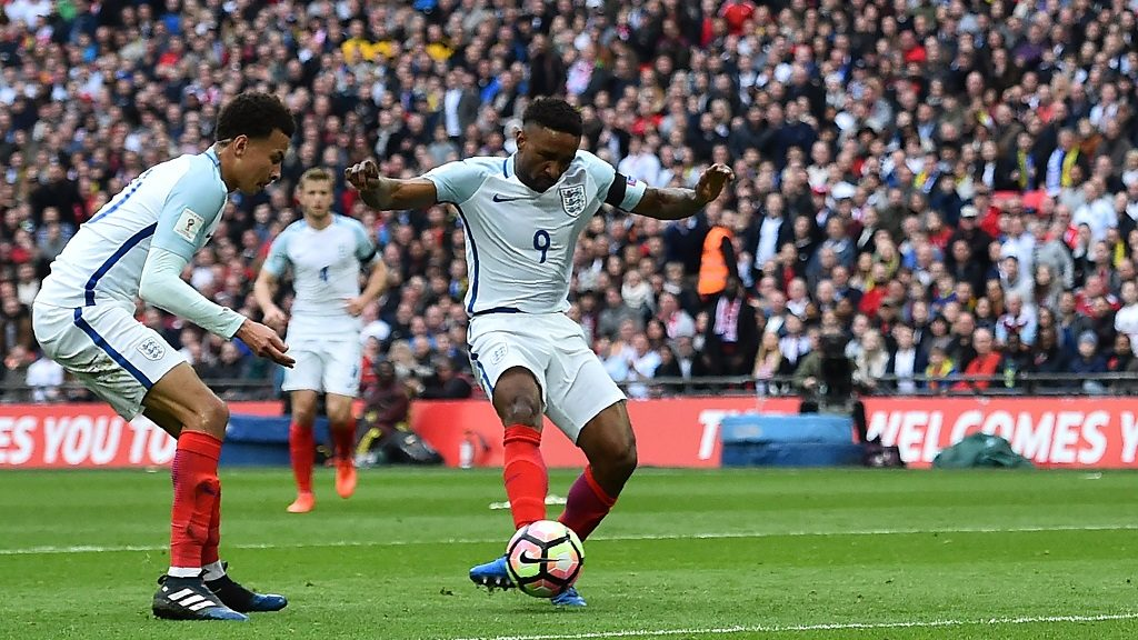 England's striker Jermain Defoe (C) shoots to score his team's first goal during the World Cup 2018 qualification football match between England and Lithuania at Wembley Stadium in London on March 26, 2017.  / AFP PHOTO / Glyn KIRK / NOT FOR MARKETING OR ADVERTISING USE / RESTRICTED TO EDITORIAL USE