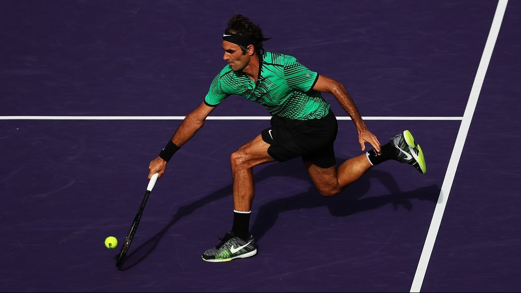 KEY BISCAYNE, FL - MARCH 30: Roger Federer of Switzerland returns a shot against Tomas Berdych of the Czech Republic during Day 11 of the Miami Open at Crandon Park Tennis Center on March 30, 2017 in Key Biscayne, Florida.   Al Bello/Getty Images/AFP