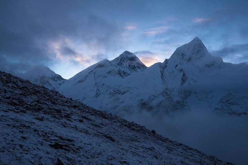 KALA PATTHAR, SOLU-KHUMBU - SEPTEMBER 29: Kala Patthar or (black rock) is around 5600m high and is known to give the best view of Mt Everest, it's a steep 2 hour climb and usually starts around 4am. It is worth the effort. Everests (8848m) at sunrise sitting between Changtse (7543m) and Nuptse (7861m) on September 29, 2016 in Kala Patthar, Nepal. The trails in the Solu-Khumbu region of Nepal are stunning, winding their way through the highest mountain range on Earth all the way to the top of the top, Mt Everest. Trekkers from all over flock to the region every season to get their own view of the 8848m peak, but for locals living in the mountains these trails are a way of life, the veins of productivity between villages. Mountain workers haul everything up the peaks using yaks and their own back; food, supplies for teahouses, gear for trekking and climbing expeditions. It takes around 10 days just to get to Everest base camp, and a healthy tourism sector is vital for the region. On April 25, 2015 that all changed when Nepal was struck by a powerful 7.8 magnitude earthquake killing almost 9000 people. The damage extended from Kathmandu deep into the Khumbu region where an avalanche from nearby Pumori swept through Everest base camp, killing 22 climbers. Just 17 days later another 7.3 magnitude quake hit the region. It is the worst natural disaster to hit Nepal in over 80 years with an estimated damage bill of $10 billion  USD, half of Nepal's GDP. Almost two years since the quake and the trails are still unusually quiet, teahouses have a couple of visitors but just as many staff. Adventure tourism has been battered with climbing and trekking clientele falling by around 50 per cent. With the trekking industry accounting for a $120 million boost to the economy, it is a big hit for one of the poorest countries in Southeast Asia.  (Photo by Heath Holden/Getty Images)