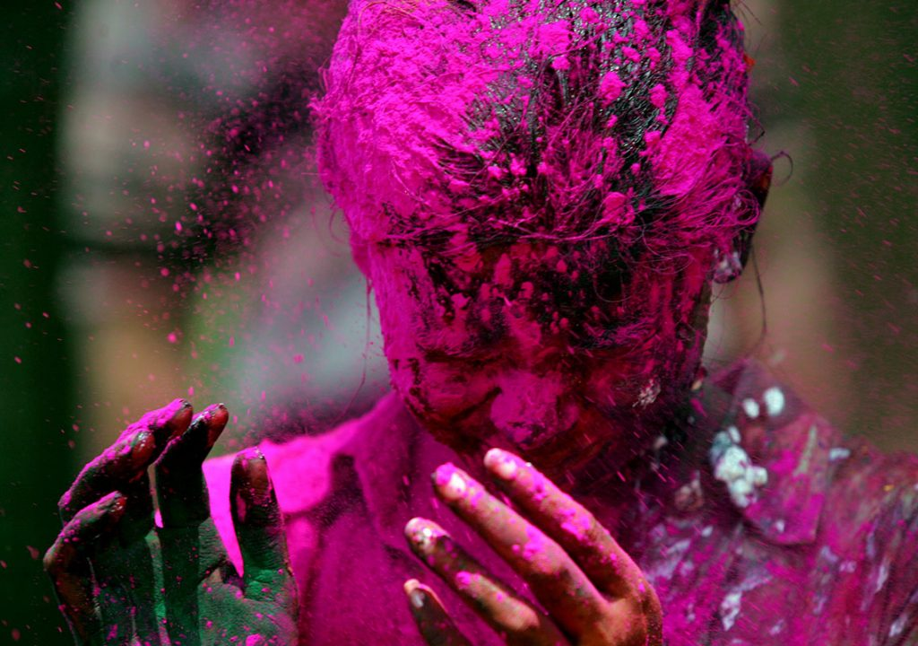MUMBAI, INDIA - MARCH 22, 2008: Holi Festival - Sneha Sawant reacts to being smeared with coloured powder during the celebration of Hindu religious festival of Holi in Mumbai. (Photo by Rajanish Kakade/Hindustan Times via Getty Images)