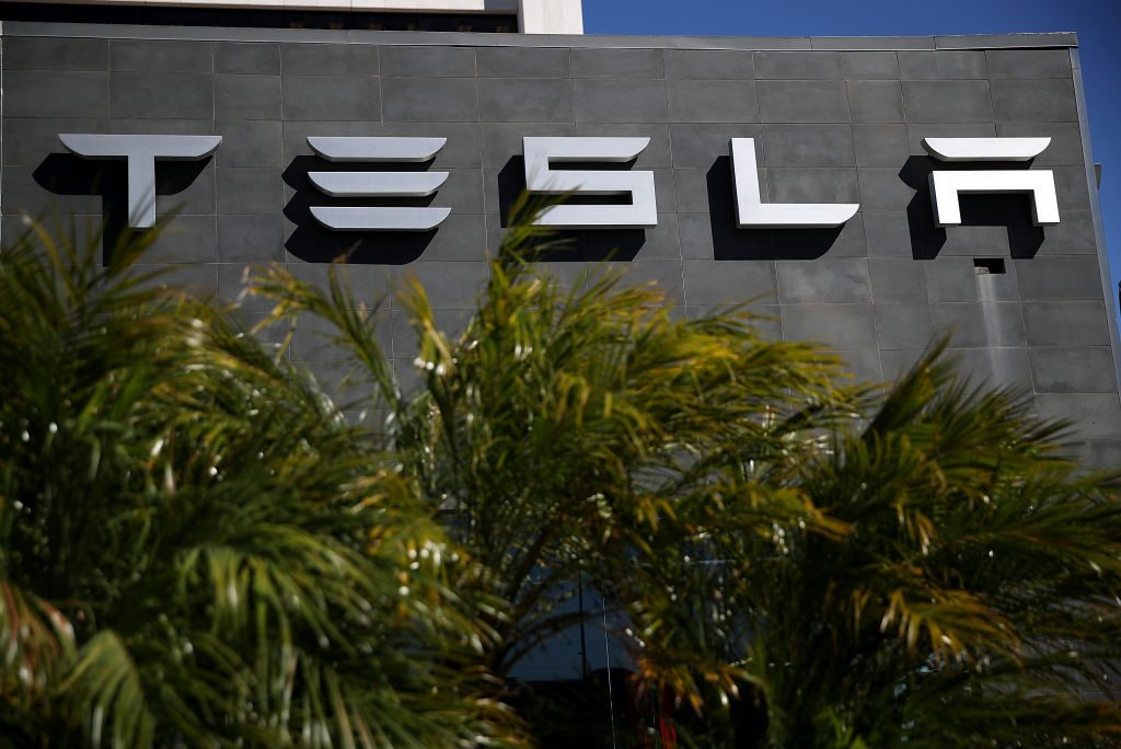 LOS ANGELES, CA - FEBRUARY 23:  A sign is posted in on the exterior of a Tesla service center on February 23, 2017 in Los Angeles, California. Tesla shares dropped over 5 percent on Thursday  after a mixed fourth quarter earnigns report. The electric car company reported better-than-expected revenue  of $2.28 billion compared to a projected  estimate of $2.2 billion. The earnings were up 88% year over year, but well below the previous quarter's growth of 145%. The company also reported a per-share loss minus items of 69 cents.  (Photo by Justin Sullivan/Getty Images)