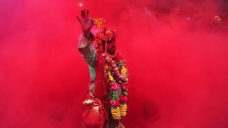 "MATHURA, UTTAR PRADESH, INDIA - 2017/03/05: A Hindu devotee takes part in Laddu maar Holi at ""Radha Rani Temple"" at Barsana, Mathura in India. (Photo by Prabhat Kumar Verma/Pacific Press/LightRocket via Getty Images)"