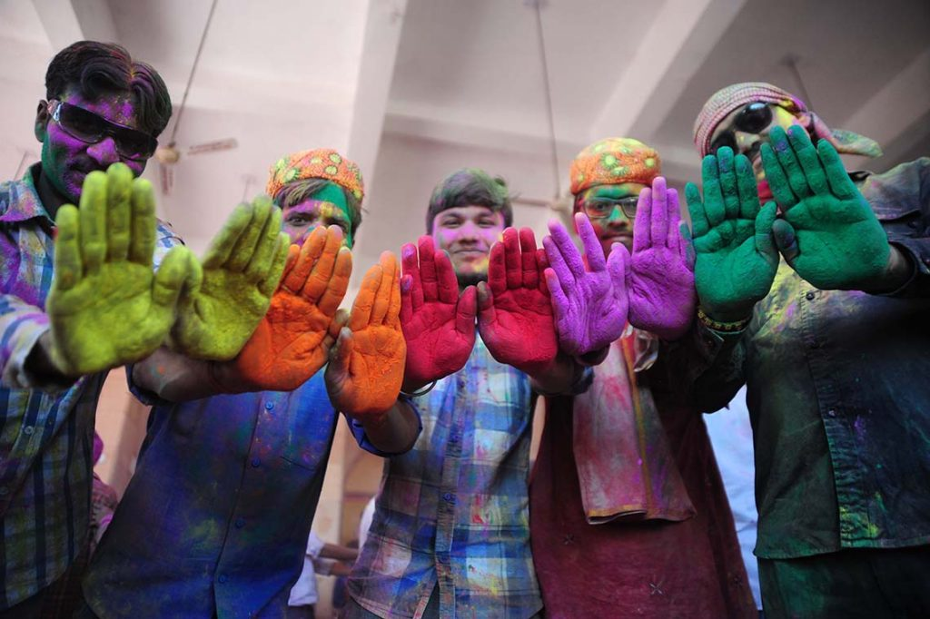 MATHURA, UTTAR PRADESH, INDIA - 2017/03/06: Devotees with color powder in their hands react to camera during Lathmar Holi festival celebration at Radha Rani temple. (Photo by Prabhat Kumar Verma/Pacific Press/LightRocket via Getty Images)