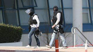 Armed French policemen wearing bulletproof jacket walk at the Tocqueville high school in the southern French town of Grasse, on March 16, 2017 following a shooting that left two people injured.